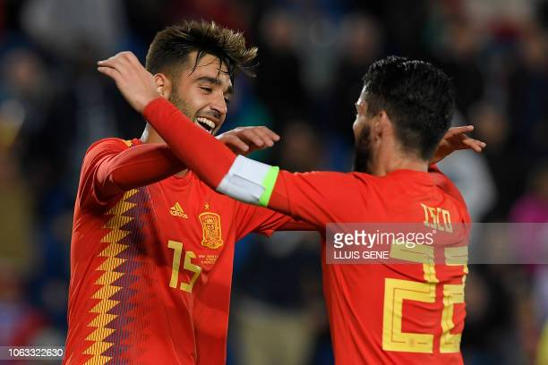 Spain's midfielder Brais Mendez celebrates a goal with Spain's midfielder Isco during the international friendly football match between Spain and...