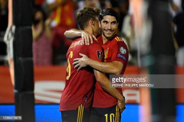 Spain's midfielder Carlos Soler celebrates scoring his team's second goal during the FIFA World Cup Qatar 2022 European qualifying round group B...