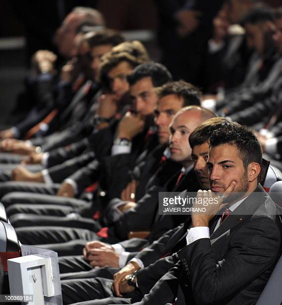 Spain's midfielder Cesc Fabregas and teammates listen to Spain's Prince Felipe during the inauguration of RFEF museum on May 24 2010 at the Sports...