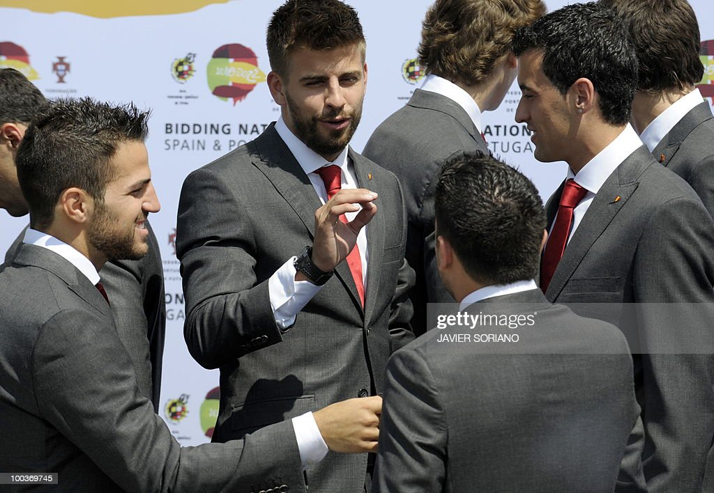 Spain's midfielder Cesc Fabregas, defender Albert Pique, midfielders Xavi Hernandez and Segio Busquets chat before taking a group picture during the inauguration of Spanish Football Team museum on May 24, 2010 at the Sports City of Las Rozas, near Madrid. Spain, among the favourites for the World Cup, which runs from June 11-July 11, face Switzerland, Honduras and Chile in Group H of the opening round.