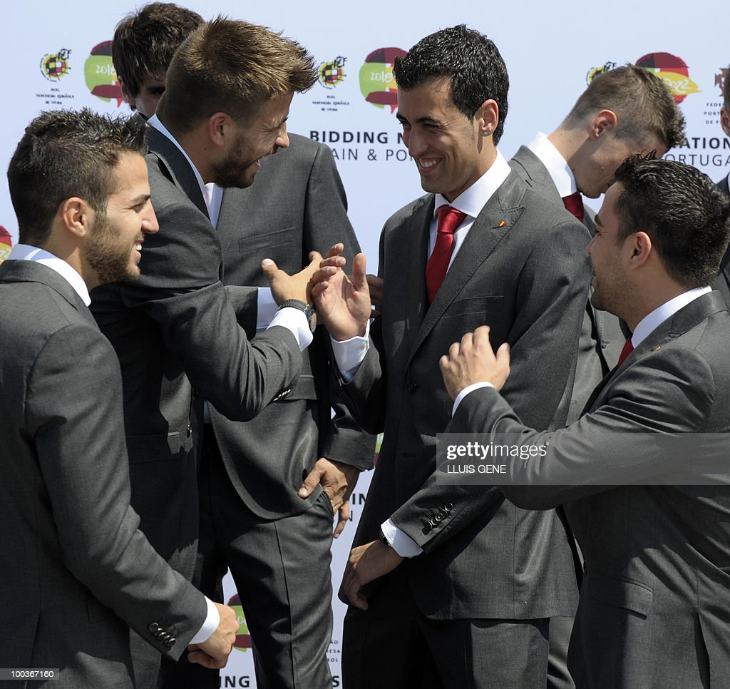 Spain's midfielder Cesc Fabregas, defender Gerard Pique and midfielders Sergi Busquets and Xavi Hernandez gather for a group picture of the Spanish football team with Spain's Prince Felipe on May 24, 2010, at the Sports City of Las Rozas, near Madrid. Spain, among the favourites for the World Cup, which runs from June 11-July 11, face Switzerland, Honduras and Chile in Group H of the opening round.
