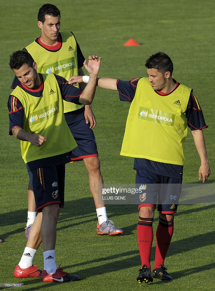 Spain's midfielder Cesc Fabregas (L), Spain's forward David Villa (R) and Spain's midfielder Sergi Busquets (C) take part in a training session of the Spanish football team with Spain's Prince Felipe on May 24, 2010, at the Sports City of Las Rozas, near Madrid. Spain among the favourites for the World Cup, which runs from June 11-July 11, face Switzerland, Honduras and Chile in Group H of the opening round.