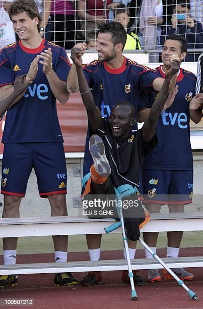 Spain's midfielder Cesc Fabregas Spain's forward Pedro Rodriguez and Spain's forward Fernando Llorente pose with Sierra Leone's war amputees football...