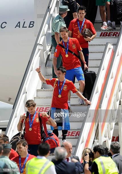Spain's midfielder Cesc Fabregas Spain's midfielder Xabi Alonso Spain's forward David Villa and Spain's forward Fernando Llorente arrive at Barajas'...