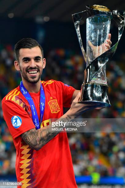 Spain's midfielder Dani Ceballos holds the winners trophy after Spain won the final match of the UEFA U21 European Football Championships against...