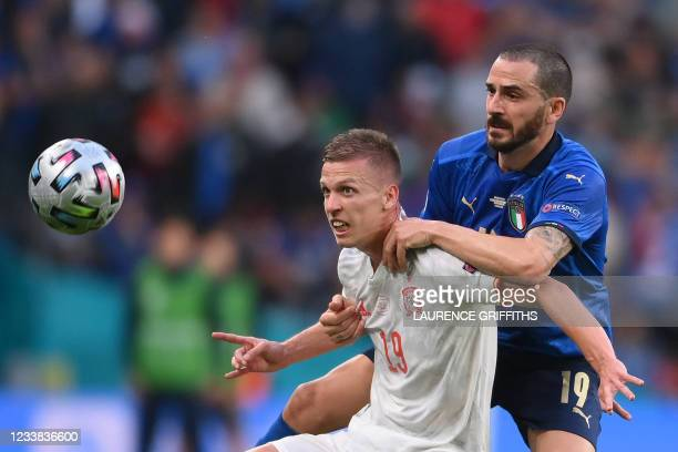 Spain's midfielder Daniel Olmo fights for the ball with Italy's defender Leonardo Bonucci during the UEFA EURO 2020 semi-final football match between...