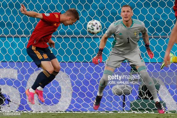 Spain's midfielder Daniel Olmo heads the ball past Sweden's goalkeeper Robin Olsen during the UEFA EURO 2020 Group E football match between Spain and...