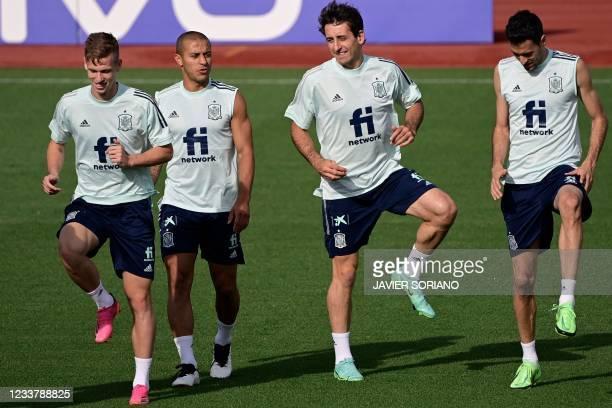 Spain's midfielder Daniel Olmo, Spain's midfielder Thiago Alcantara, Spain's forward Mikel Oiarzabal and Spain's midfielder Sergio Busquets take part...