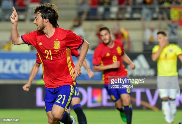 Spain's midfielder David Silva celebrates a goal during the friendly international football match Spain vs Colombia at the Condomina stadium in...