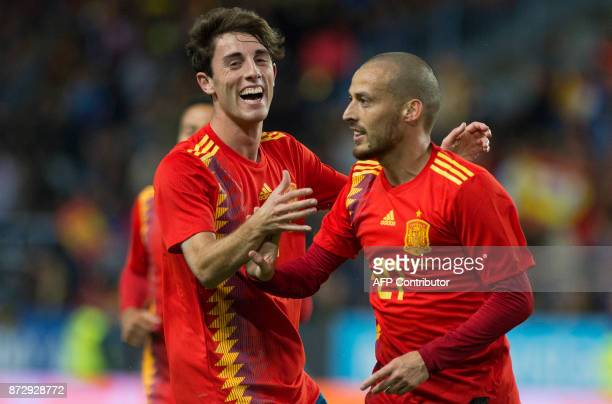 Spain's midfielder David Silva celebrates a goal with defender Alvaro Odriozola after scoring a goal during the international friendly football match...