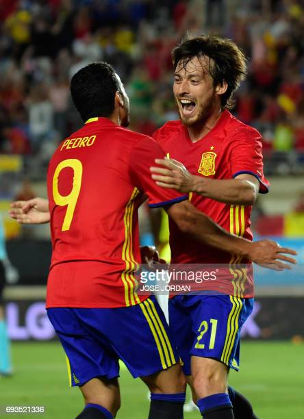 Spain's midfielder David Silva celebrates a goal with Spain's midfielder Pedro during the friendly international football match Spain vs Colombia at...