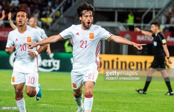 Spain's midfielder David Silva celebrates after scoring a goal during the FIFA World Cup 2018 qualification football match between Macedonia and...