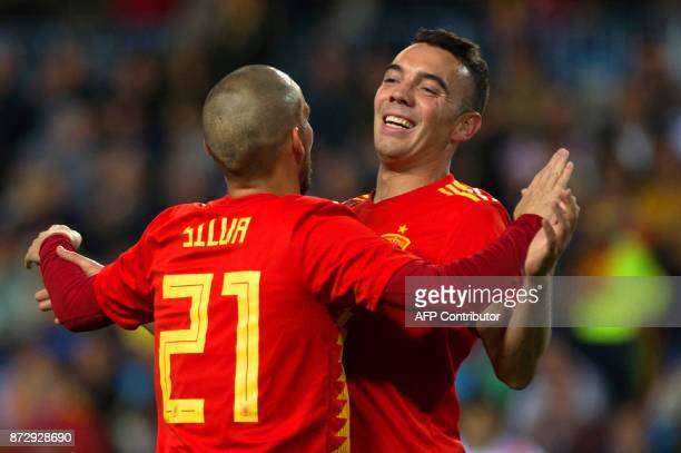 Spain's midfielder David Silva celebrates with Spain's forward Iago Aspas after scoring a goal during the international friendly football match Spain...