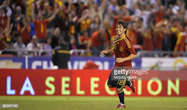 Spain's midfielder David Silva runs celebrating a goal against Belgium during their World Cup 2010 qualifier football match at the Riazor Stadium in...