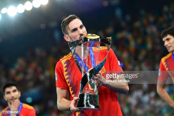 Spain's midfielder Fabian Ruiz and the tournament's best players kisses the winners' trophy after Spain won the final match of the UEFA U21 European...