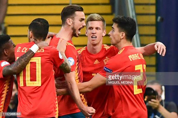 Spain's midfielder Fabian Ruiz celebrates with Spain's forward Dani Olmo and Spain's defender Marc Roca after opening the scoring during the final...