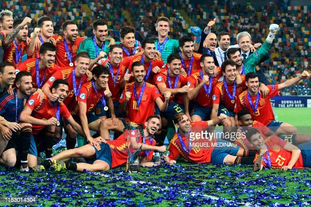 Spain's midfielder Fabian Ruiz Spain's defender Pol Lirola Spain's midfielder Dani Ceballos and teammates celebrate with the winners trophy after...