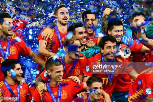 Spain's midfielder Fabian Ruiz , Spain's forward Dani Olmo , Spain's midfielder Mikel Oyarzabal and teammates celebrate after Spain won the final...