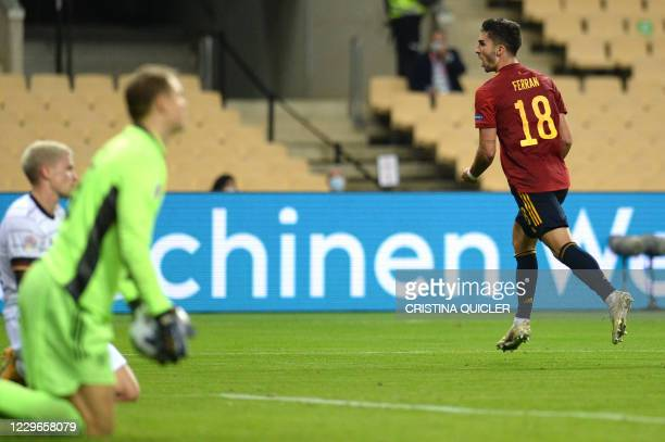 Spain's midfielder Ferran Torres celebrates his first goal during the UEFA Nations League footbal match between Spain and Germany at La Cartuja...