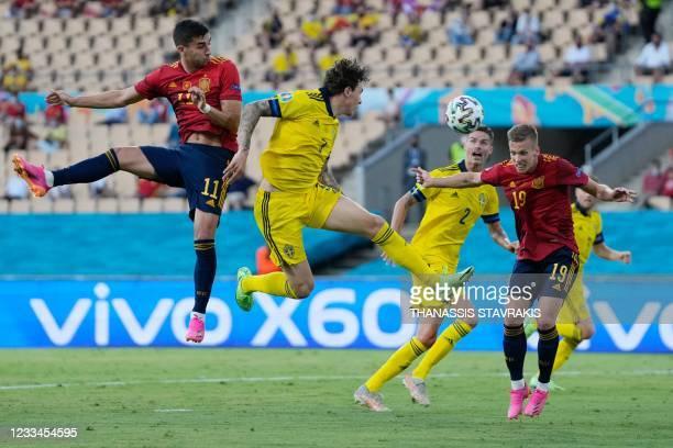 Spain's midfielder Ferran Torres, Sweden's defender Victor Lindelof and Spain's midfielder Daniel Olmo vie for the header during the UEFA EURO 2020...