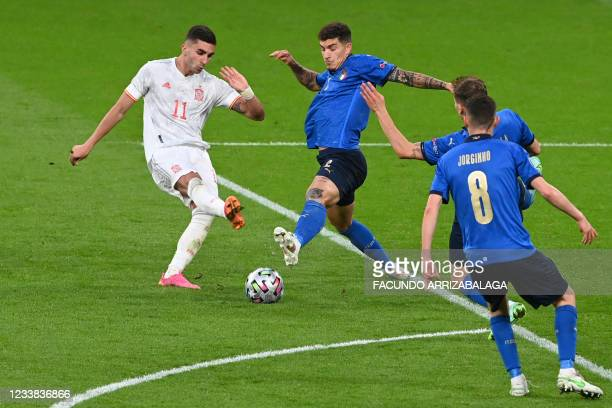 Spain's midfielder Ferran Torres takes a shot during the UEFA EURO 2020 semi-final football match between Italy and Spain at Wembley Stadium in...