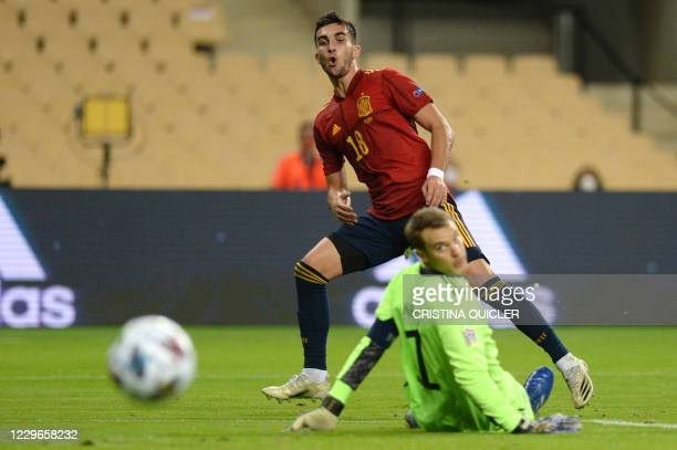 Spain's midfielder Ferran Torres vies with Germany's goalkeeper Manuel Neuer during the UEFA Nations League footbal match between Spain and Germany...
