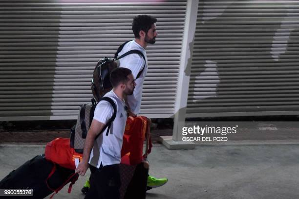 Spain's midfielder Isco and Spain's defender Dani Carvajal arrive at Barajas Adolfo Suarez international airport in Madrid on July 2 a day after...