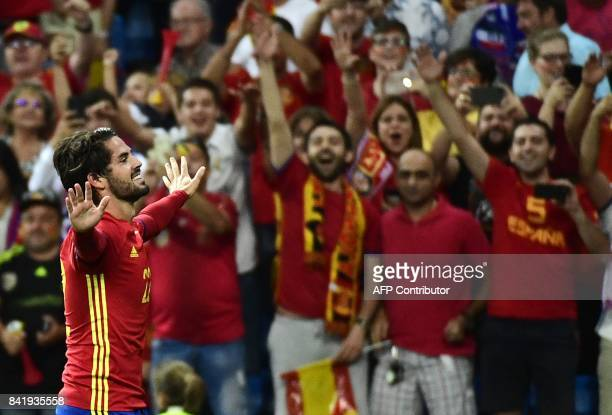 TOPSHOT Spain's midfielder Isco celebrates a goal during the World Cup 2018 qualifier football match between Spain and Italy at the Santiago Bernabeu...