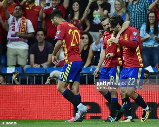Spain's midfielder Isco celebrates a goal with Spain's defender Jordi Alba during the World Cup 2018 qualifier football match between Spain and Italy...
