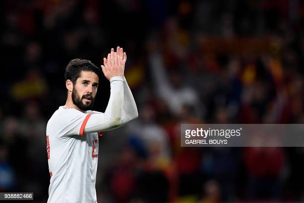 Spain's midfielder Isco celebrates after scoring a goal during a friendly football match between Spain and Argentina at the Wanda Metropolitano...