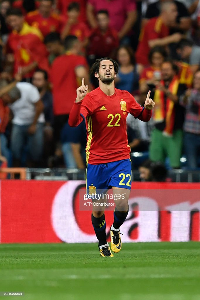 Spain's midfielder Isco celebrates after scoring during the World Cup 2018 qualifier football match Spain vs Italy at the Santiago Bernabeu stadium in Madrid on September 2, 2017. /