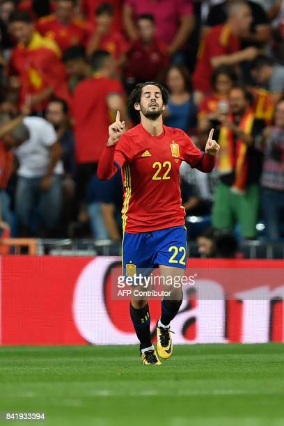 Spain's midfielder Isco celebrates after scoring during the World Cup 2018 qualifier football match Spain vs Italy at the Santiago Bernabeu stadium...