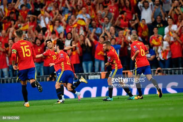 Spain's midfielder Isco celebrates after scoring his second goal during the World Cup 2018 qualifier football match Spain vs Italy at the Santiago...