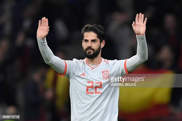 Spain's midfielder Isco celebrates after scoring his team's third goal during a friendly football match between Spain and Argentina at the Wanda...