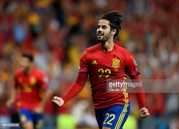 Spain's midfielder Isco celebrates after scoring the opening goal during the FIFA 2018 World Cup Qualifier between Spain and Italy at Estadio...