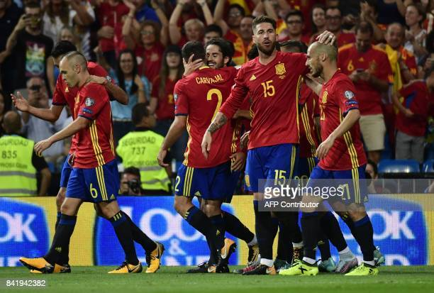 Spain's midfielder Isco celebrates his second goal with teammates during the World Cup 2018 qualifier football match between Spain and Italy at the...