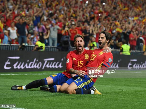 Spain's midfielder Isco celebrates with Sergio Ramos after scoring the opening goal during the FIFA 2018 World Cup Qualifier between Spain and Italy...