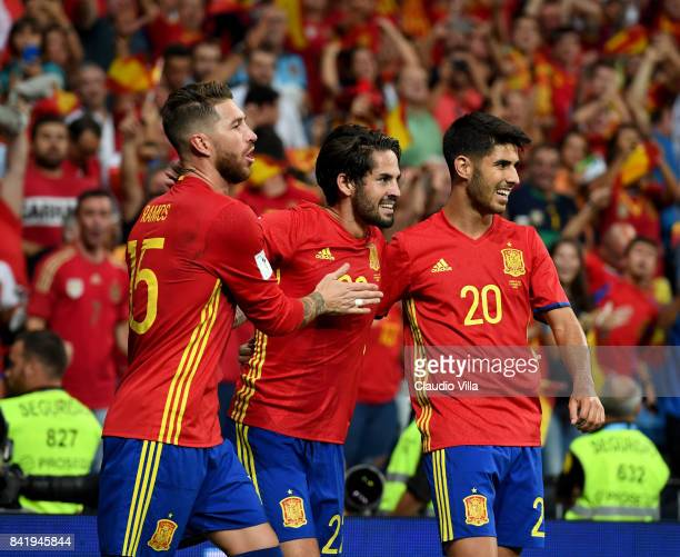 Spain's midfielder Isco celebrates with Sergio Ramos and Marco Asensio after scoring the his second goal during the FIFA 2018 World Cup Qualifier...
