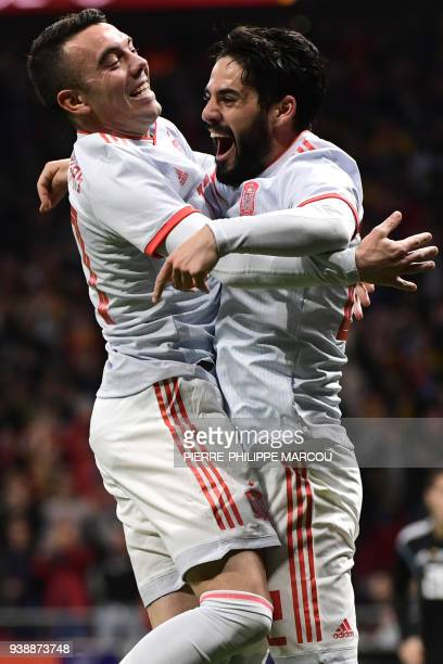 Spain's midfielder Isco celebrates with Spain's forward Iago Aspas after scoring his team's third goal during a friendly football match between Spain...