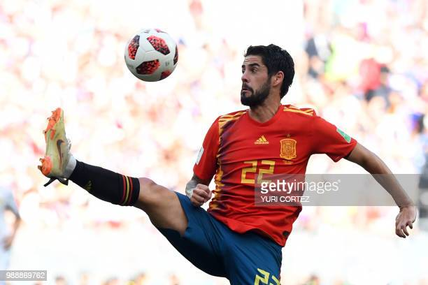 Spain's midfielder Isco controls the ball during the Russia 2018 World Cup round of 16 football match between Spain and Russia at the Luzhniki...