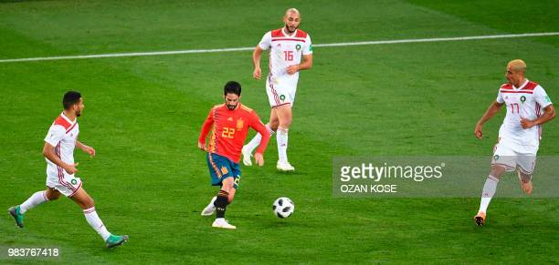 Spain's midfielder Isco controls the ball past Morocco's forward Noureddine Amrabat and Morocco's defender Nabil Dirar during the Russia 2018 World...