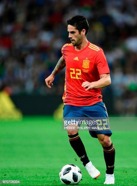 Spain's midfielder Isco dribbles the ball during the friendly football match between Spain and Tunisia at Krasnodar's stadium on June 9 2018