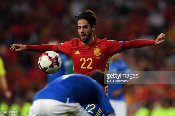 Spain's midfielder Isco eyes the ball during the World Cup 2018 qualifier football match Spain vs Italy at the Santiago Bernabeu stadium in Madrid on...