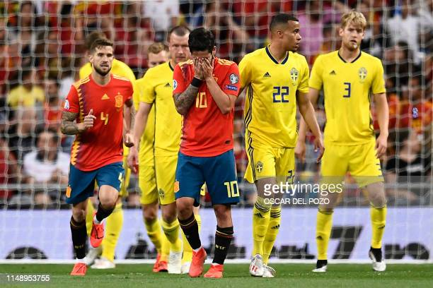 Spain's midfielder Isco reacts to missing a goal opportunity during the UEFA Euro 2020 group F qualifying football match between Spain and Sweden at...