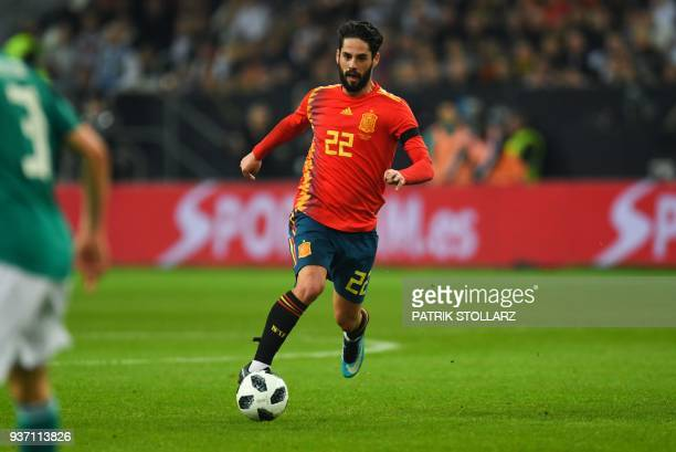 Spain's midfielder Isco runs with the ball during the international friendly football match of Germany vs Spain in Duesseldorf western Germany on...
