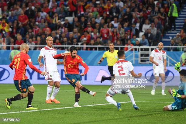 Spain's midfielder Isco scores a goal during the Russia 2018 World Cup Group B football match between Spain and Morocco at the Kaliningrad Stadium in...