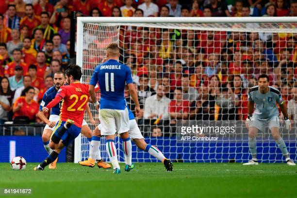 Spain's midfielder Isco scores his second goal during the World Cup 2018 qualifier football match Spain vs Italy at the Santiago Bernabeu stadium in...