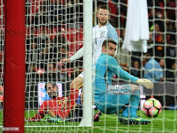 Spain's midfielder Isco scores his team's second goal past England's goalkeeper Tom Heaton during the friendly international football match between...