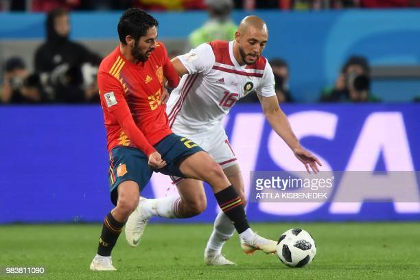 Spain's midfielder Isco vies with Morocco's forward Noureddine Amrabat during the Russia 2018 World Cup Group B football match between Spain and...