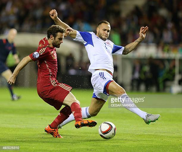 Spain's midfielder Juan Mata vies with Luxembourg's defender Maxime Chanot during the Euro 2016 qualifying football match Spain vs Luxembourg at Las...